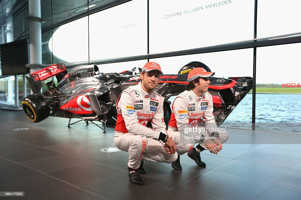 McLaren Mercedes Formula 1 drivers <a gi-track='captionPersonalityLinkClicked' href=/galleries/search?phrase=Jenson+Button&family=editorial&specificpeople=171505 ng-click='$event.stopPropagation()'>Jenson Button</a> of Great Britain and Sergio Perez of Mexico unveil the Mercedes McLaren MP4-28 at the McLaren technology centre on January 31, 2013 in Woking, England.
