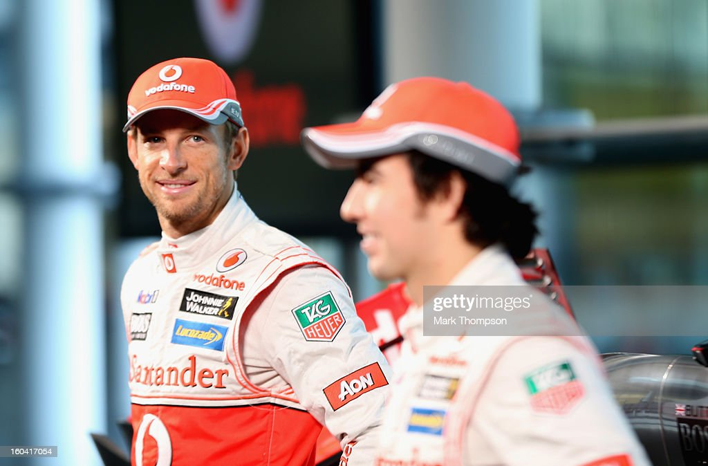 McLaren Mercedes Formula 1 drivers <a gi-track='captionPersonalityLinkClicked' href=/galleries/search?phrase=Jenson+Button&family=editorial&specificpeople=171505 ng-click='$event.stopPropagation()'>Jenson Button</a> of Great Britain and Sergio Perez of Mexico prepare to unveil the Mercedes McLaren MP4-28 at the McLaren technology centre on January 31, 2013 in Woking, England.