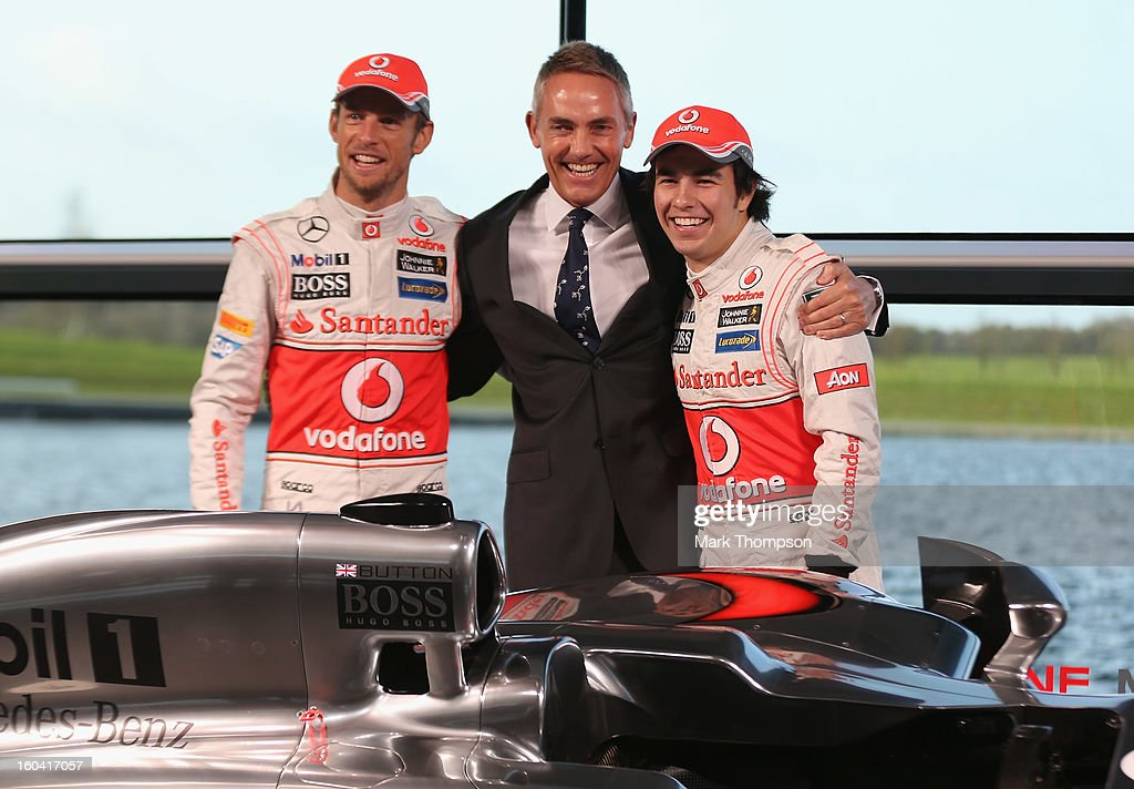 McLaren Mercedes Formula 1 drivers <a gi-track='captionPersonalityLinkClicked' href=/galleries/search?phrase=Jenson+Button&family=editorial&specificpeople=171505 ng-click='$event.stopPropagation()'>Jenson Button</a> (L) of Great Britain and Sergio Perez (R) of Mexico with team principal <a gi-track='captionPersonalityLinkClicked' href=/galleries/search?phrase=Martin+Whitmarsh&family=editorial&specificpeople=2374153 ng-click='$event.stopPropagation()'>Martin Whitmarsh</a> at the unveiling of the Mercedes McLaren MP28 at the McLaren technology centre on January 31, 2013 in Woking, England.