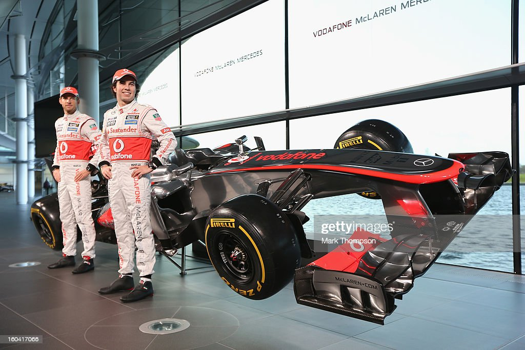 McLaren Mercedes Formula 1 drivers Jenson Button of Great Britain and Sergio Perez of Mexico unveil the Mercedes McLaren MP4-28 at the McLaren technology centre on January 31, 2013 in Woking, England.