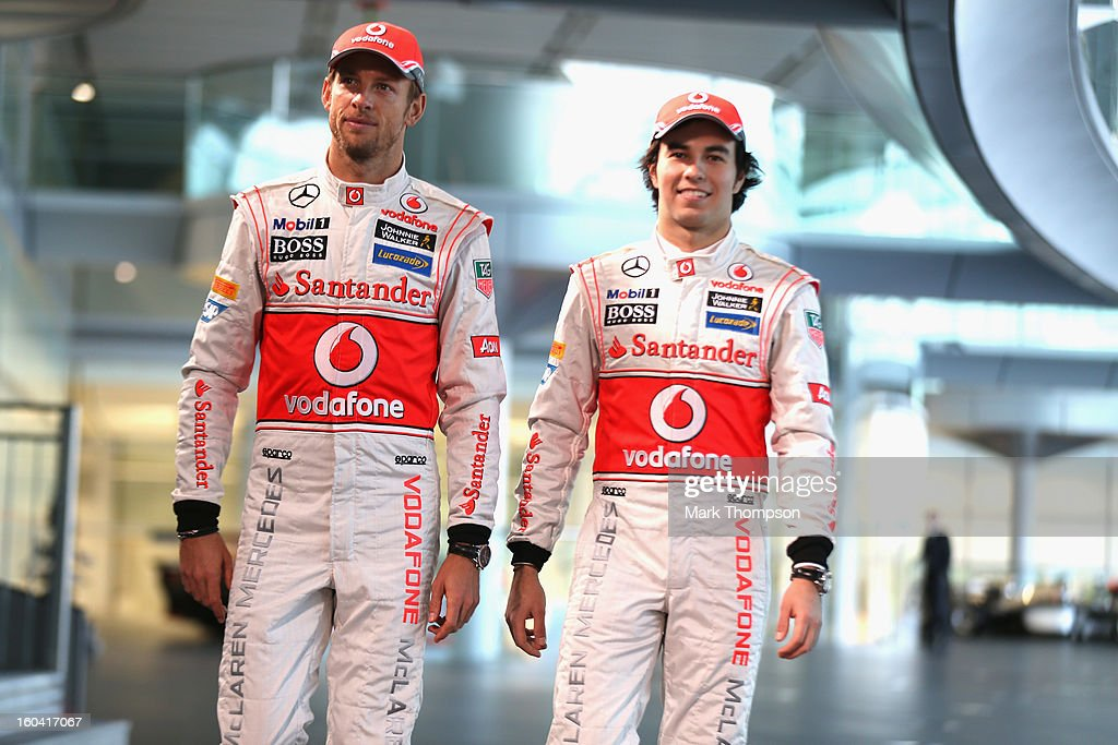 McLaren Mercedes Formula 1 drivers Jenson Button of Great Britain and Sergio Perez of Mexico prepare to unveil the Mercedes McLaren MP4-28 at the McLaren technology centre on January 31, 2013 in Woking, England.