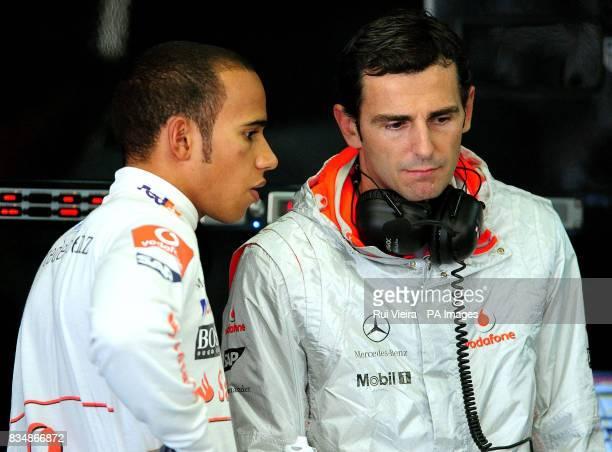 McLaren Mercedes' Lewis Hamilton in the pits with McLaren test driver Pedro De La Rosa after free practice at Interlagos Sao Paulo Brazil