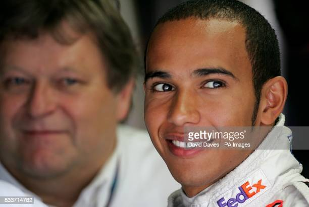 McLaren Mercedes' Lewis Hamilton with Mercedes Motorsport Director Norbert Haug during a practice session at the Hungaroring