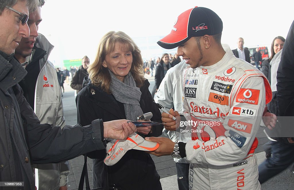 McLaren race car driver <a gi-track='captionPersonalityLinkClicked' href=/galleries/search?phrase=Lewis+Hamilton+-+Racecar+Driver&family=editorial&specificpeople=586983 ng-click='$event.stopPropagation()'>Lewis Hamilton</a> signs autographs while promoting Vodafone at the CeBIT technology trade fair on March 1, 2011 in Hanover, Germany. CeBIT 2011 will be open to the public from March 1-5.