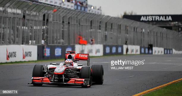 McLarenMercedes driver Jenson Button of Britain emerges out of the gloom to win Formula One's Australian Grand Prix in Melbourne on March 28 2010...