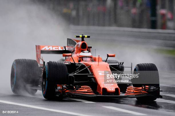 McLaren's Belgian driver Stoffel Vandoorne drives as it rains during the third practice session at the Autodromo Nazionale circuit in Monza on...