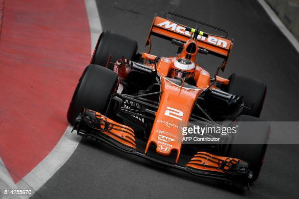 McLaren's Belgian driver Stoffel Vandoorne drives during the first practice session at the Silverstone motor racing circuit in Silverstone central...
