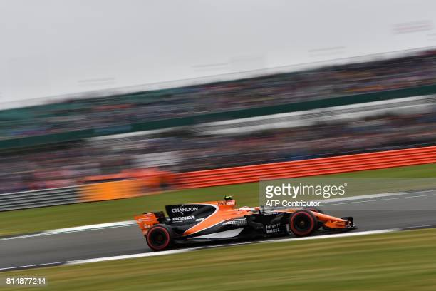 McLaren's Belgian driver Stoffel Vandoorne drives during the qualifying session at the Silverstone motor racing circuit in Silverstone central...