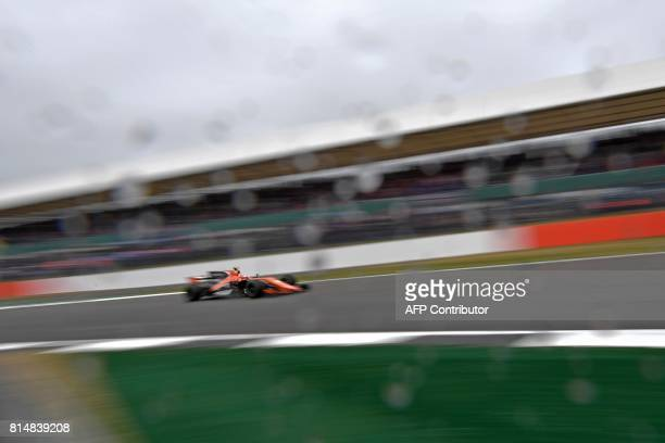 McLaren's Belgian driver Stoffel Vandoorne drives during the third practice session at the Silverstone motor racing circuit in Silverstone central...