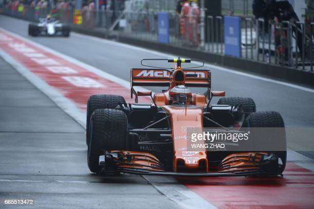McLaren's Belgian driver Stoffel Vandoorne drives out of the pits during the first practice session ahead of the Formula One Chinese Grand Prix in...