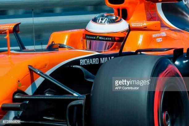 McLaren's Belgian driver Stoffel Vandoorne powers his car during the Brazilian Formula One Grand Prix practice session at the Interlagos circuit in...
