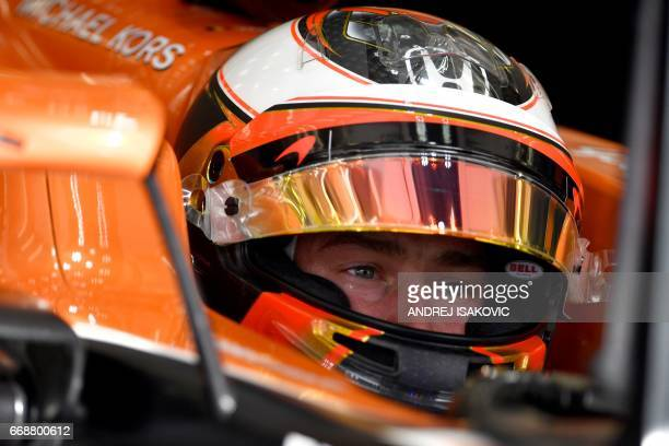 McLaren's Belgian driver Stoffel Vandoorne prepares in the pits during the third practice session ahead of qualifying for the Bahrain Formula One...