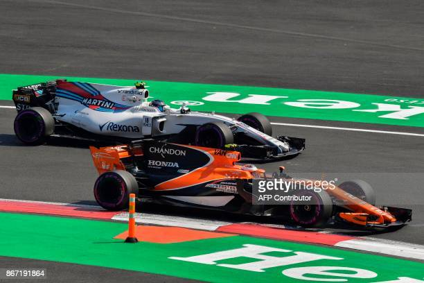 McLaren's Belgium F1 driver Stoffel Vandoorne passes Williams's Canadian driver Lance Stroll during the second free practice of the F1 Mexico Grand...