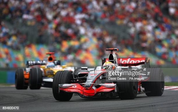Mclaren's Lewis Hamilton gets away from former team mate Fernando Alonso in the Renault during the Grand Prix at MagnyCours Nevers France