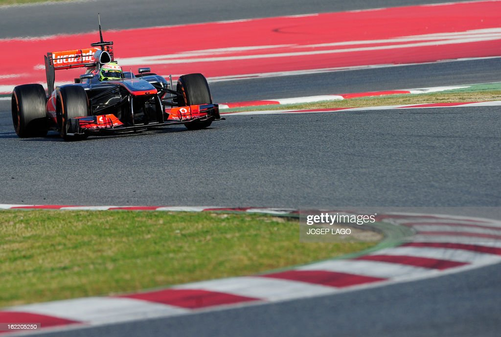 McLaren's Mexican driver Sergio Perez drives during the second day of Formula One testing at the Catalunya racetrack in Montmelo, near Barcelona, on February 20, 2013. AFP PHOTO / JOSEP LAGO