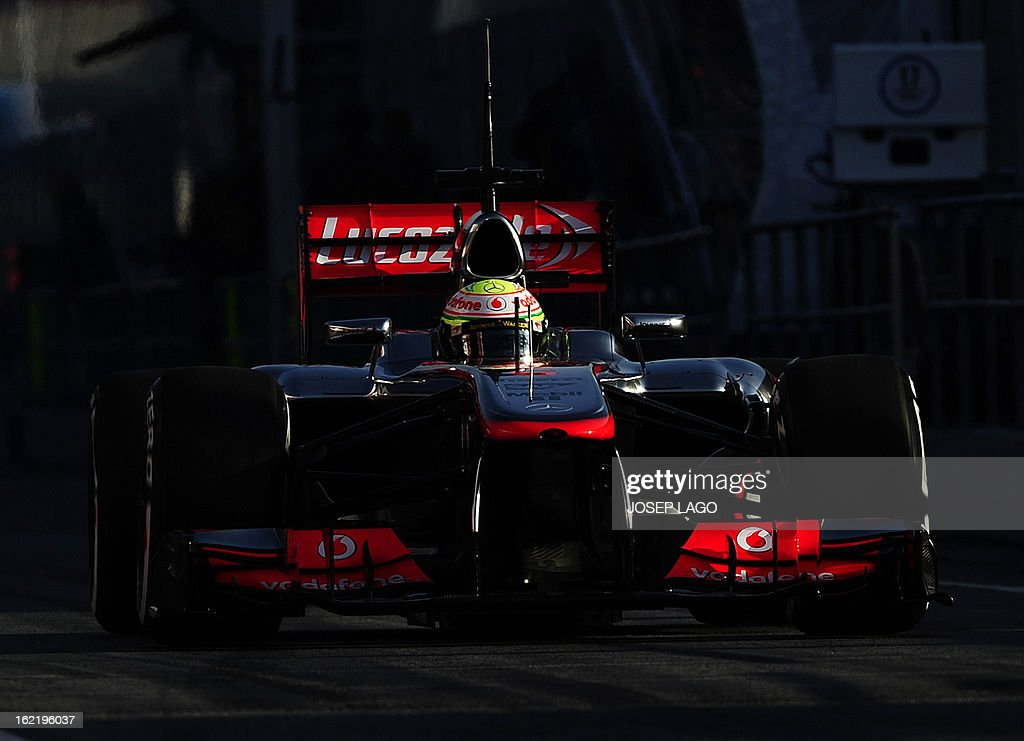 McLaren's Mexican driver Sergio Perez enters the pits during the second day of Formula One testing at Catalunya racetrack in Montmelo, near Barcelona, on February 20, 2013.