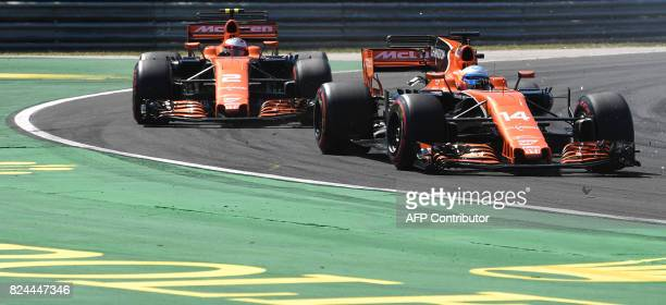 McLaren's Spanish driver Fernando Alonso and McLaren's Belgian driver Stoffel Vandoorne race at the Hungaroring circuit in Budapest on July 30 during...