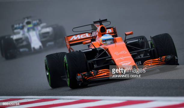 McLaren's Spanish driver Fernando Alonso drives his car during the Formula One Chinese Grand Prix in Shanghai on April 9 2017 / AFP PHOTO / Johannes...
