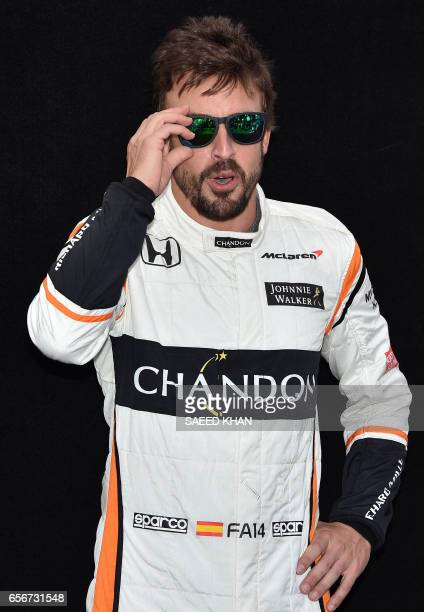 McLaren's Spanish driver Fernando Alonso poses for a photo in Melbourne on March 23 ahead of the Formula One Australian Grand Prix / AFP PHOTO /...