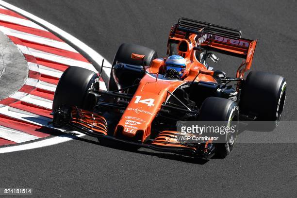 McLaren's Spanish driver Fernando Alonso races during a free practice session at the Hungaroring racing circuit in Budapest on July 29 2017 prior to...