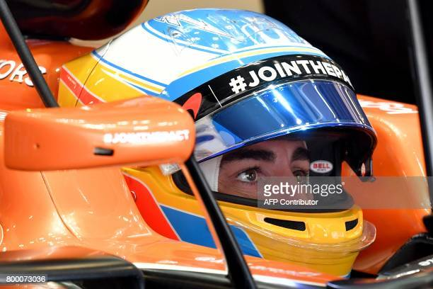 McLaren's Spanish driver Fernando Alonso sits in his car during the first practice session of the Formula One Azerbaijan Grand Prix at the Baku City...