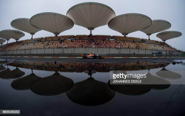 McLaren's Spanish driver Fernando Alonso steers his car during the first practice of the Formula One Chinese Grand Prix in Shanghai on April 7 2017 /...