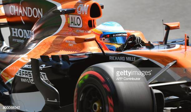 McLaren's Spanish driver Fernando Alonso steers his car during the first practice session of the Formula One Azerbaijan Grand Prix at the Baku City...