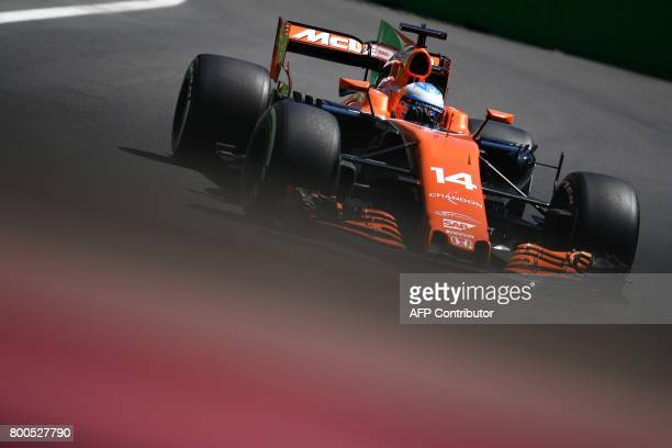 McLaren's Spanish driver Fernando Alonso steers his car during the third practice session of the Formula One Azerbaijan Grand Prix at the Baku City...