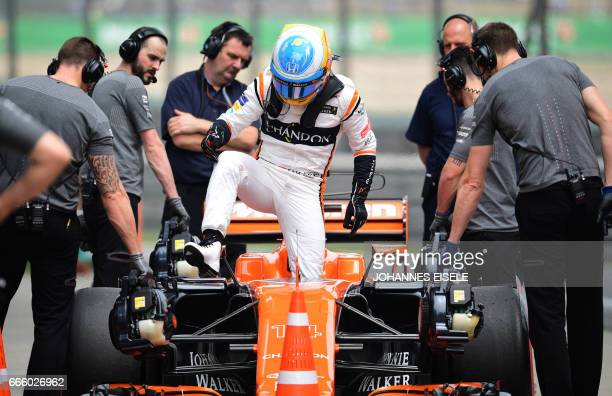 McLaren's Spanish driver Fernando Alonso steps out of his car after the third practice session of the Formula One Chinese Grand Prix in Shanghai on...