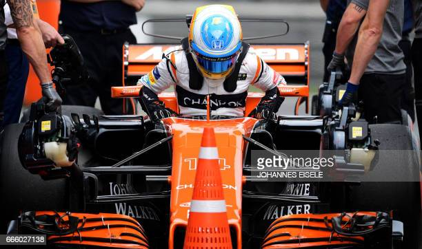 McLaren's Spanish driver Fernando Alonso steps out of his car after the third practice session for the Formula One Chinese Grand Prix in Shanghai on...