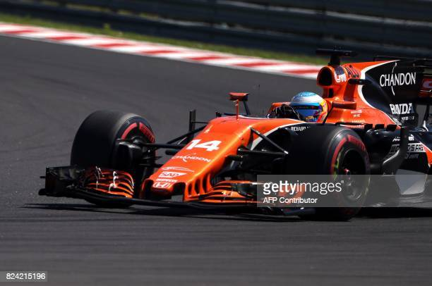McLaren's Spanish driver Fernando Alonso takes part in the qualifying at the Hungaroring racing circuit in Budapest on July 29 2017 prior to the...