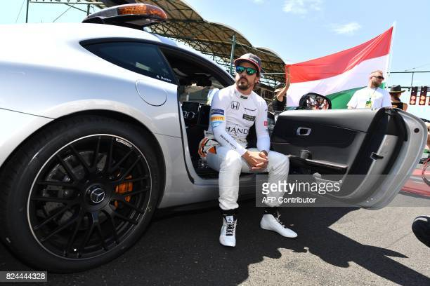 McLaren's Spanish driver Fernando Alonso waits for the start of the race at the Hungaroring racing circuit in Budapest on July 30 prior to the...