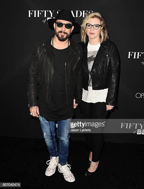 McLean and wife Rochelle Deanna Karidis attend the premiere of 'Fifty Shades of Black' at Regal Cinemas LA Live on January 26 2016 in Los Angeles...