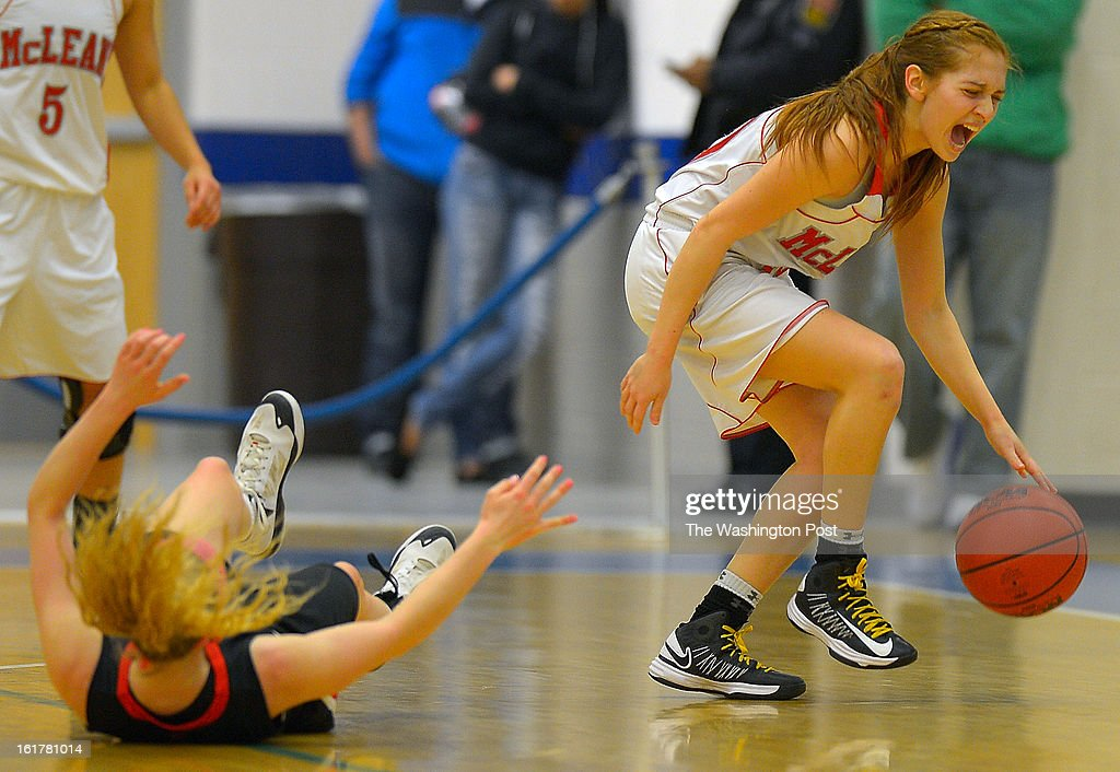 Mclean's Camila Prock, right, is in a pain as she collided with Madison's Katie Kerrigan, left, as Madson defeats McLean in the Virginia AAA Liberty District girls basketball tournament finals at South Lakes High School in Reston VA, February 15, 2012 .