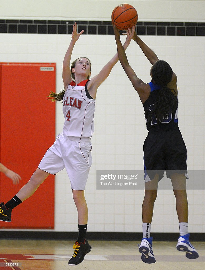McLean's Jessica Monroe, left, and Fairfax's No'ell Taylor vie for a rebound as McLean defeats Fairfax 58 - 37 in girls basketball at McLean High School in McLean VA, January 11, 2012 .