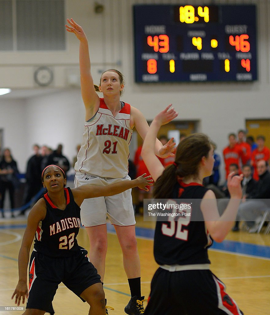 McLean's Louisa Murphy , center, ties the game up with a 3 point shot with about 18 seconds to go in the game as Madison defeats McLean 48 - 46 in the Virginia AAA Liberty District girls basketball tournament finals at South Lakes High School in Reston VA, February 15, 2012 .