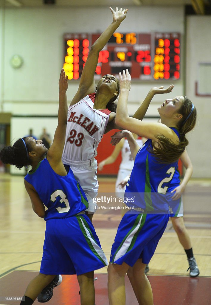 McLean's Maia Lee center spits the defense of South Lake's Sasha Sprei left and Abigail Rendle right for a 2nd half shot as McLean defeats South...