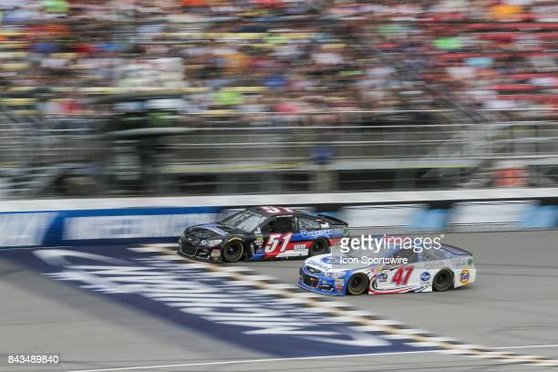 J McLeod driver of the Corrigan Oil Chevrolet and AJ Allmendinger driver of the Kroger ClickList Chevrolet race during the Monster Energy NASCAR Cup...
