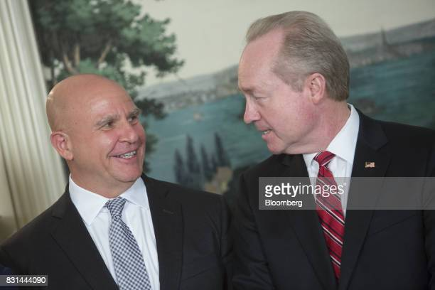 HR McMaster national security advisor left speaks to Thomas Kennedy chairman and chief executive officer of Raytheon Co during a signing of a...