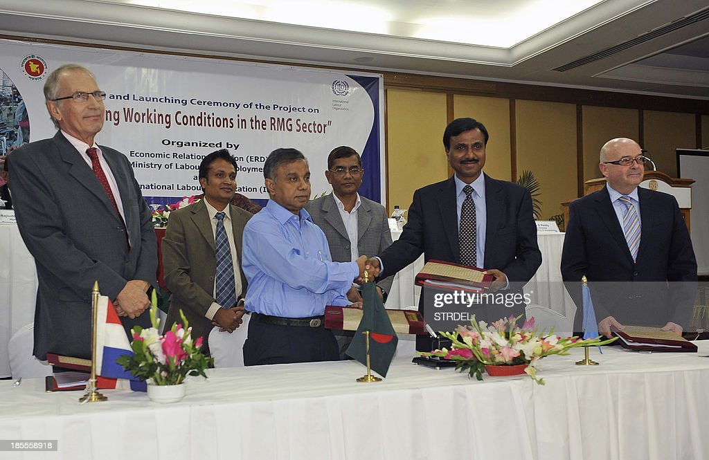 Md Abul Kalam Azad, Secretary of the Economic Relations Division of Bangladesh (2nd L) shakes hands with International Labour Organization (ILO) Dhaka Office Director Srinivas B. Reddy (2nd R) while Netherlands Ambassador to Bangladesh Gerben Sjoerd de Jong (L) and British High Commissioner to Bangladesh Robert W. Gibson (R) look on during a signing ceremony in Dhaka on October 22, 2013. Bangladesh and the International Labour Organization (ILO) launched a $24 million safety campaign in the latest effort to overhaul appalling conditions at the nation's clothing factories, officials said. Experts will conduct safety inspections at more than 1,000 factories as part of the multi-year campaign, after a garment factory collapse in April that killed 1,132 people highlighted inadequate safety standards in the industry.