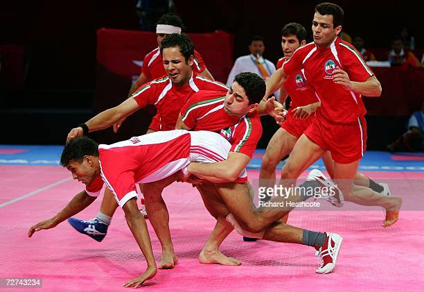 Md Mozammal Haque of Bangladesh is taken down by the Islamic Republic of Iran during the Men's Kabaddi Bronze Medal match between the Islamic...
