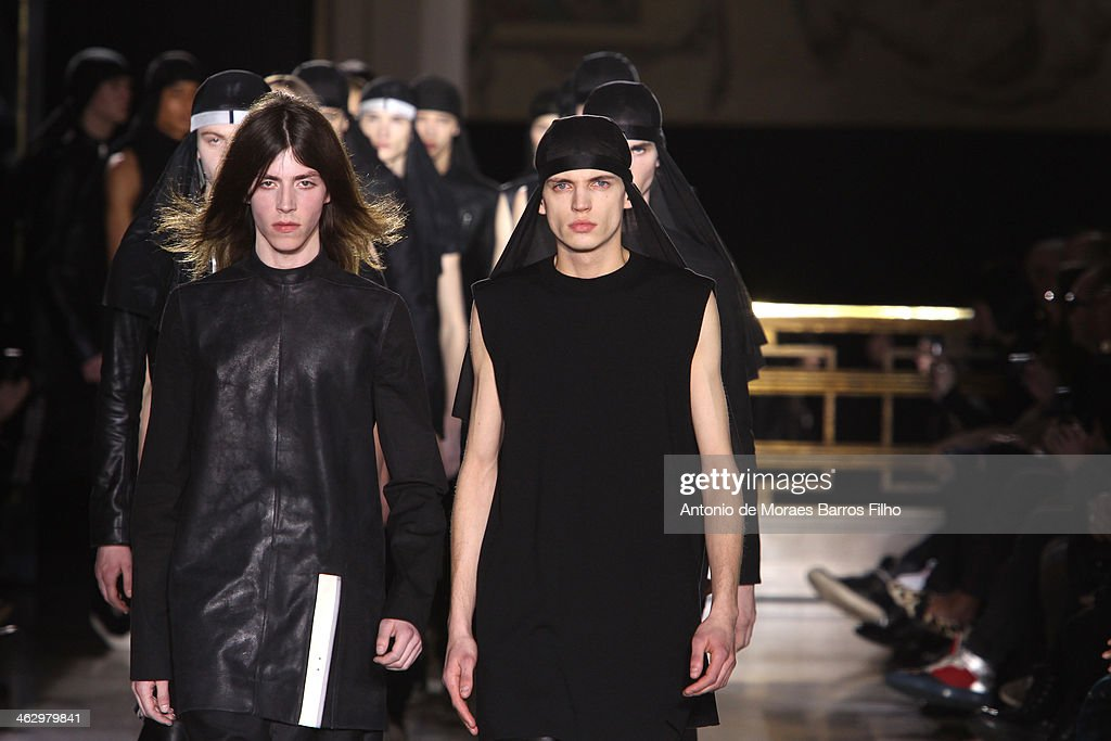 Mdels walk the runway during the Rick Owens Menswear Fall/Winter 2014-2015 show as part of Paris Fashion Week on January 16, 2014 in Paris, France.