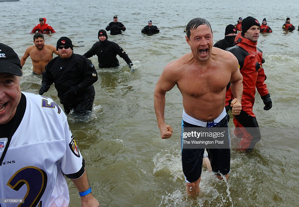 Maryland Governor Martin O'Malley lets out a scream as he jumps out of the Chesapeake Bay as he participates in the 15th annual Polar Bear Plunge on...