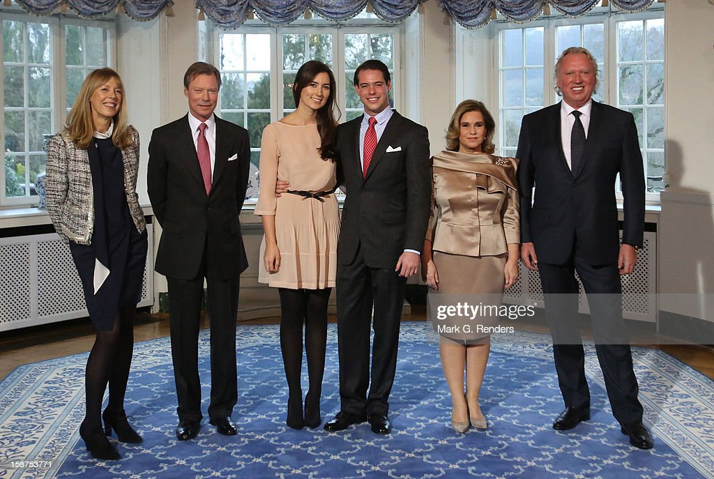 Mdme Lademacher, Grand Duke Henri of Luxembourg, Mademoiselle Claire Lademacher, <a gi-track='captionPersonalityLinkClicked' href=/galleries/search?phrase=Prince+Felix+of+Luxembourg&family=editorial&specificpeople=6881094 ng-click='$event.stopPropagation()'>Prince Felix of Luxembourg</a>, <a gi-track='captionPersonalityLinkClicked' href=/galleries/search?phrase=Grand+Duchess+Maria+Teresa&family=editorial&specificpeople=159000 ng-click='$event.stopPropagation()'>Grand Duchess Maria Teresa</a> of Luxembourg and Mr. Lademacher attend a Portrait Session at Chateau De Berg on December 27, 2012 in Luxembourg, Luxembourg.