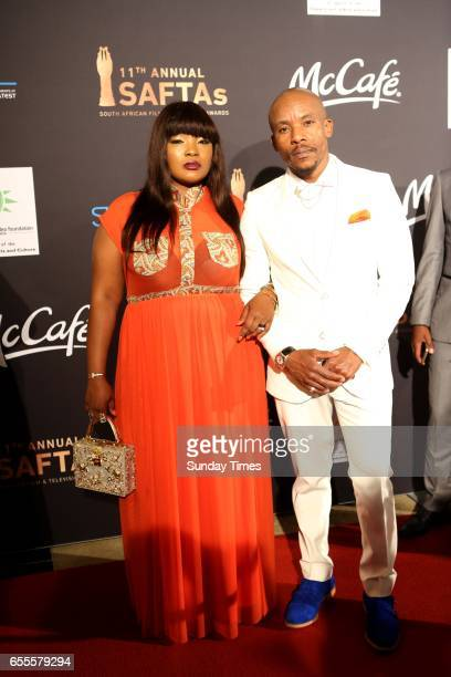 Mduduzi Mabaso and wife Fatima pose on the red carpet during the South African Film and Television Awards at Sun City on March 18 2017 in Rustenburg...