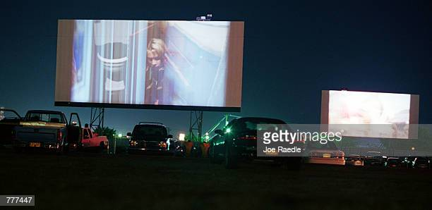 'Me Myself Irene' and 'Chicken Run' light up the screens at the Fiesta drivein movie theater in Carlsbad New Mexico August 10 2000 The death of the...