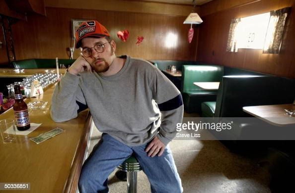 Mead Paper employee Joey Depew at Jerry's Pizza and Bar pondering benefits of Pres George W Bush's tax cut plan which could help him and his wife pay...