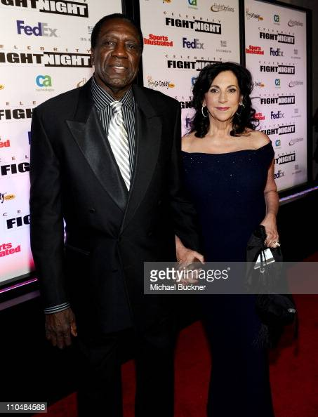 Meadowlark Lemon and guest arrive at Muhammad Ali's Celebrity Fight Night XVII at JW Marriot Desert Ridge Resort Spa on March 19 2011 in Phoenix...