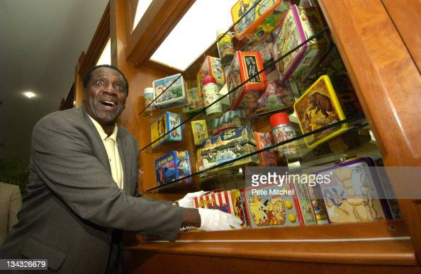 Meadowlark Lemon of the Harlem Globetrotters places the Harlem Globetrotters lunchbox into the 'Taking America to Lunch' display which opens today at...