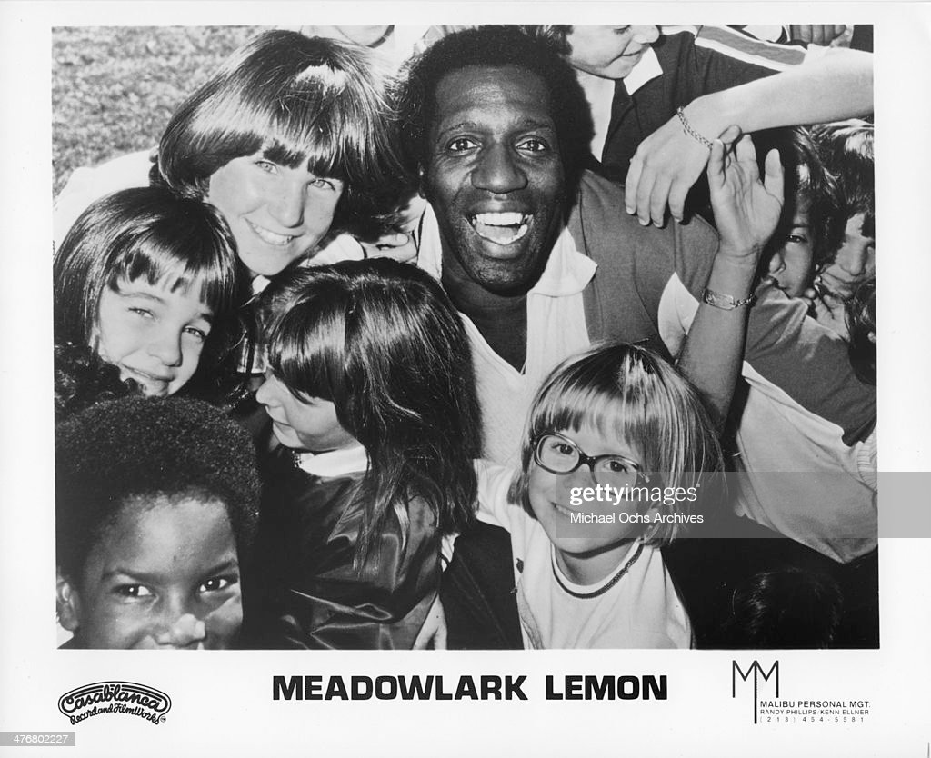 Meadowlark Lemon of the Harlem Globetrotters poses for a portrait with children circa 1970's. Lemon played with the Globetrotters from 1955-1980.